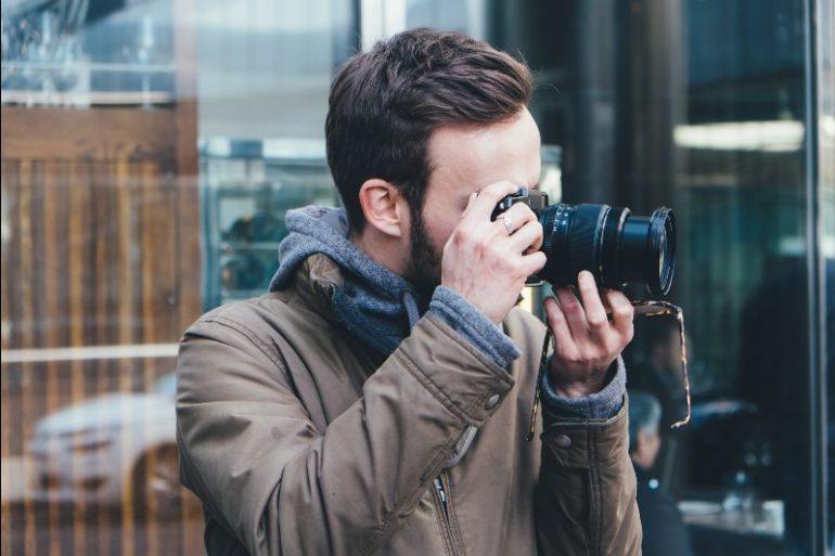 Private investigator taking picture